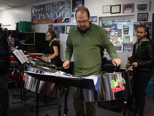 Joel Smales, director of the Juice Blenders Steel Drum Band at Binghamton High School often chooses not to conduct, but join in with the band.