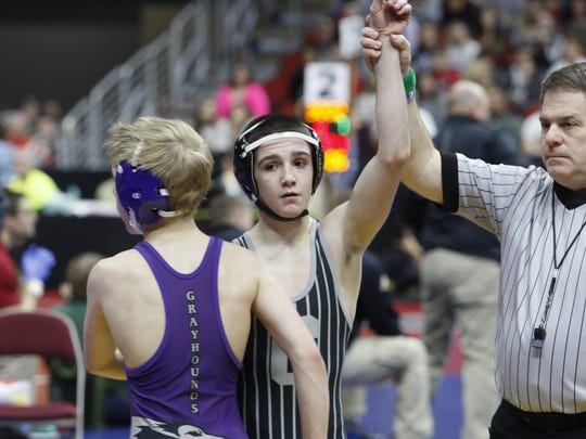 Ankeny Centennial freshman Ben Monroe posted a 16-5 major decision over Burlington's Duncan Delzell in a first-round match at 106 pounds in the Class 3A 2017 state wrestling tournament at Wells Fargo Arena.