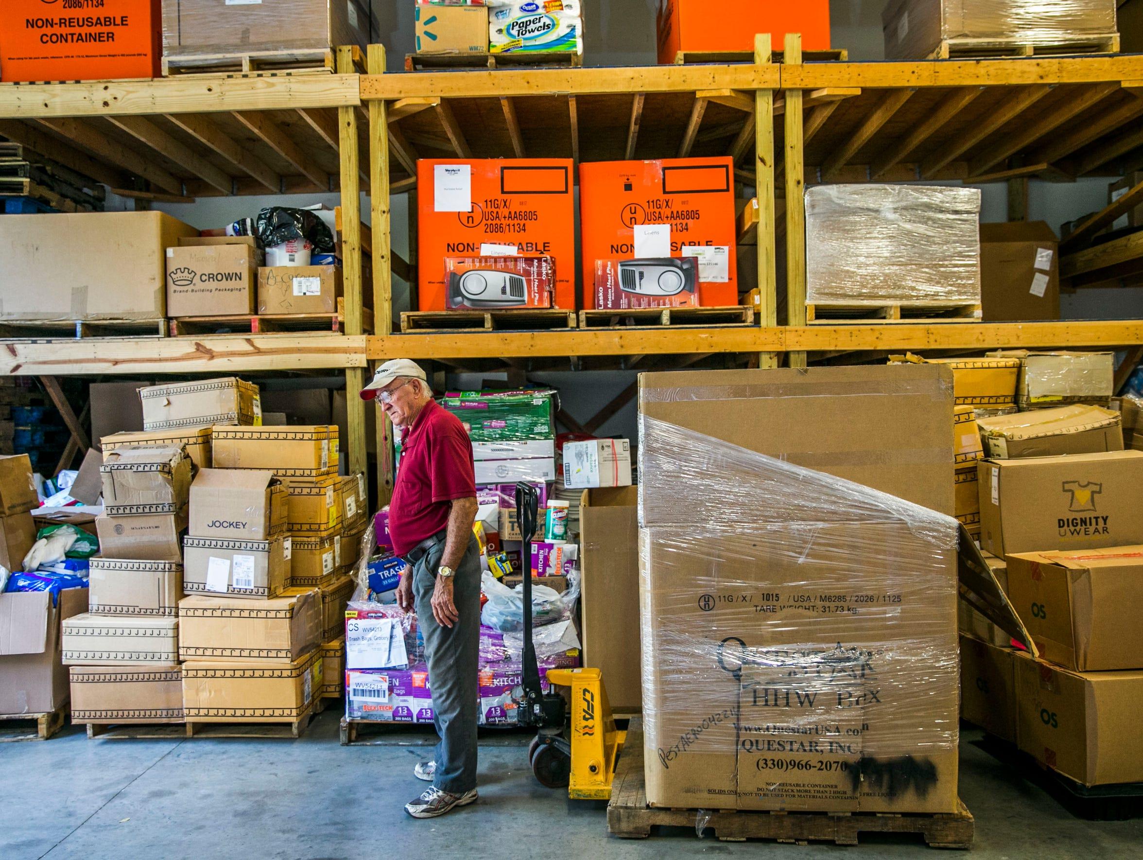 Hernan Quintero, warehouse assistant, organizes donated
