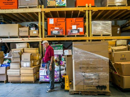 Hernan Quintero, warehouse assistant, organizes donated