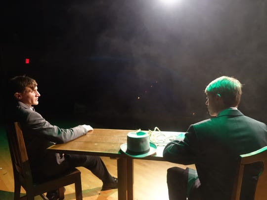"Trevor Hawkins as Sherlock Holmes and Blayden McCoy as James Larrabee in a scene from ""Sherlock Holmes"" play Wednesday and Thursday at Ridgewood High School."
