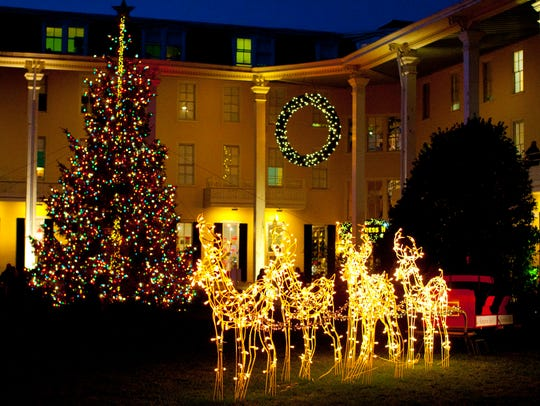 Christmas lights and reindeer decorate the courtyard