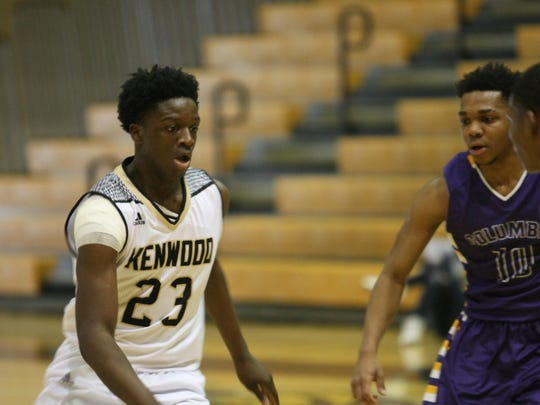 Kenwood sophomore James Williams (23) dribbles the ball against Columbia during a game in the Zaxby's Christmas Classic on Tuesday.