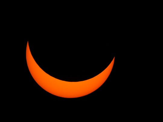A solar eclipse as seen from the Pink Shell Resort at Fort Myers Beach on Monday, August 21, 2017. A lunar eclipse will take place at 12:12 a.m. on Monday, Jan. 21.