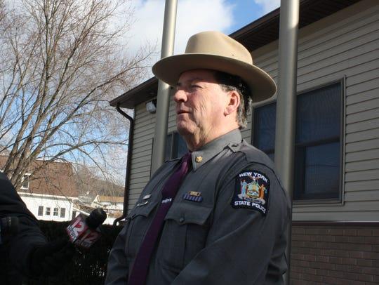 State police Maj. William McEvoy speaks prior to donating