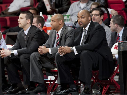 Lou Dawkins (right) is in his third year as an assistant coach at Northern Illinois University. He was hired by Mark Montgomery (center), who is a former Michigan State player and assistant coach. Dawkins formerly coached basketball at Saginaw High School.