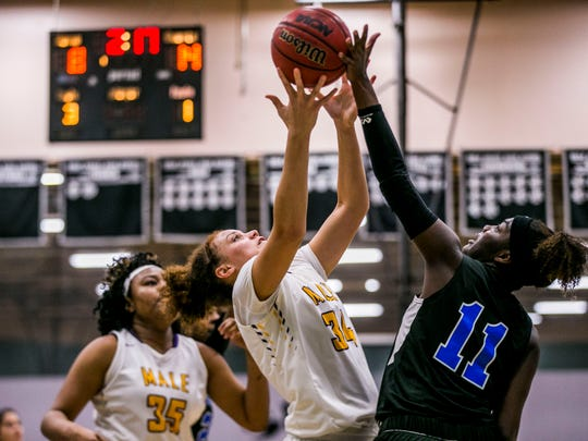 Louisville Male junior Camero Browning, left, and Westlake senior Taylor Hosendove both go for the rebound during game 13 in the Holiday Shootout at Gulf Coast High School on Friday, Dec. 29, 2017.