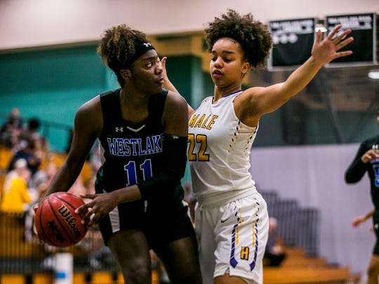 Louisville Male freshman Alana Striverson, right, blocks  Westlake senior Taylor Hosendove during game 13 in the Holiday Shootout at Gulf Coast High School on Friday, Dec. 29, 2017.