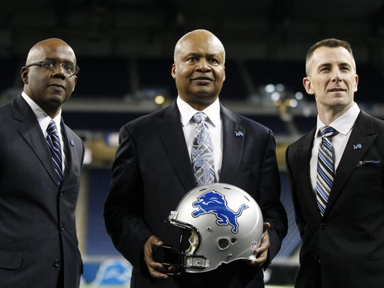 Lions general manager Martin Mayhew, left, and president Tom Lewand, right, with new head coach Jim Caldwell at Ford Field on Jan. 15, 2014.