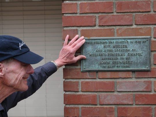 John Mahoney points out one of the many historical markers related to the works of John Steinbeck