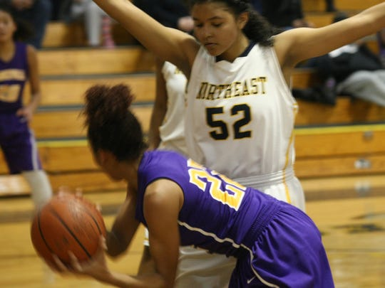 Northeast's Rachel Lopes (52) defends under the basket