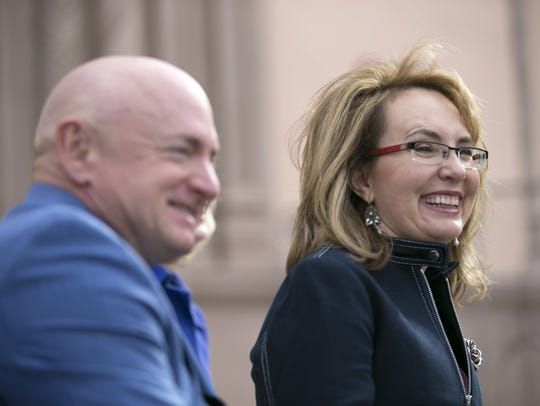 Former U.S. Rep. Gabrielle Giffords and her husband,