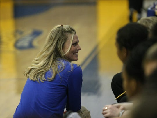 Clarksville Academy girls coach Carrie Daniels smiles in the final minute of her team's win against the University School of Nashville during a D-II, District 4 game Tuesday  night.