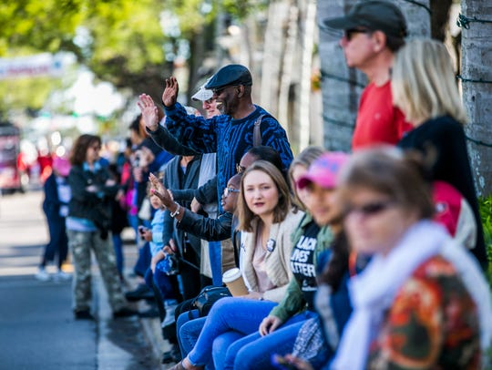 Paradegoers cheer during the Dr. Martin Luther King