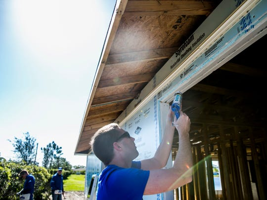 Chris Kamke, vice president of analytics for the Tampa Bay Lightning, helps build homes for Habitat for Humanity of Collier County on Tuesday. The effort is a part of the NHL's $2.7 million commitment to hurricane relief in the state of Florida.