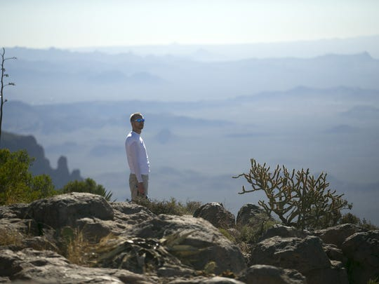 Arlen Frye of Phoenix looks across the top of the Flatiron in the Superstition Mountains. The route climbs 3,000 feet.