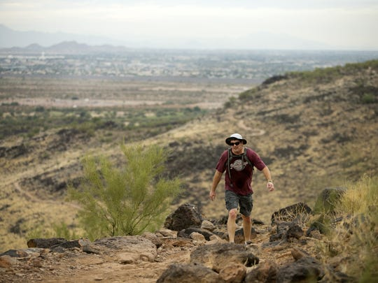 Derik Hines of Glendale hikes on the Cholla Loop Trail in the Glendale Thunderbird Conservation Park on November 17, 2017.
