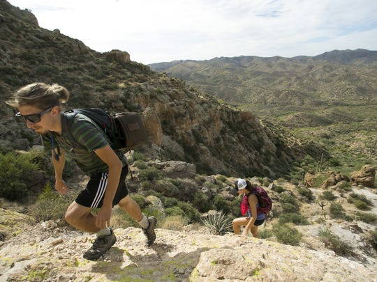 Mitch Keith of Cleveland and Claire Orman of Tempe hike to the top of Picketpost Mountain near Superior, AZ.