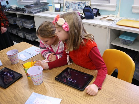 Palmer Elementary School second-graders Gabriella Forbudisi, 8, and Sophia Klolod, 7, compare the temperatures of various material during a Project Lead the Way Lesson on Jan. 9.