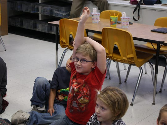 Palmer Elementary School second-grader Keith Kennedy asks a question during a lesson in engineering on Jan. 9.
