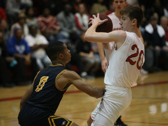 Rossview's Will Midlick tries to keep the ball away