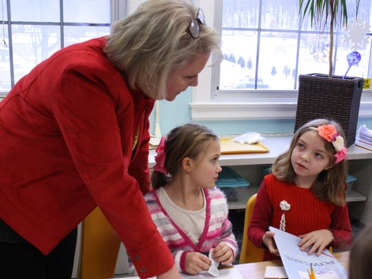 Eileen Mulcahy instructs Palmer Elementary School second-graders Gabriella Forbudisi, 8, and Sophia Klolod, 7, during a Project Lead the Way Lesson on Jan. 9.