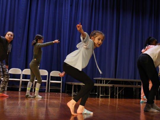 Seventh-grader Maddie Kozel, 12, rehearses a hip hop
