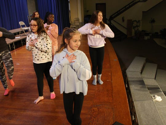 Seventh-grader Maddie Kozel, 12, rehearses a hip hop number during a dance class at West Middle School.