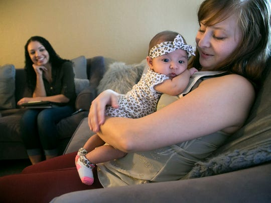 Breanna Donaldson holds Mazie, her 3-month-old daughter,