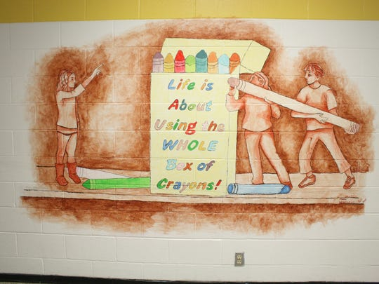A mural painted by Maine-Endwell art students hangs
