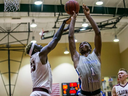 Canterbury's Berrick Jeanlouis (right) picked New Mexico State over FGCU on Tuesday.