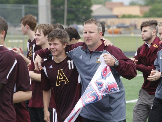 Then-Ankeny coach Brian Duax celebrates with Peter