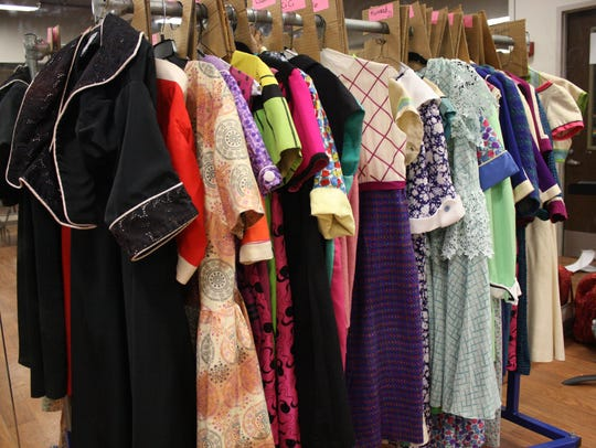"""The costumes on this rack for Johnson City High School's production of """"How to Succeed in Business Without Really Trying"""" were used in the 1995 Broadway revival of the musical."""
