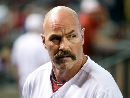 Diamondbacks interim manager Kirk Gibson looks on during