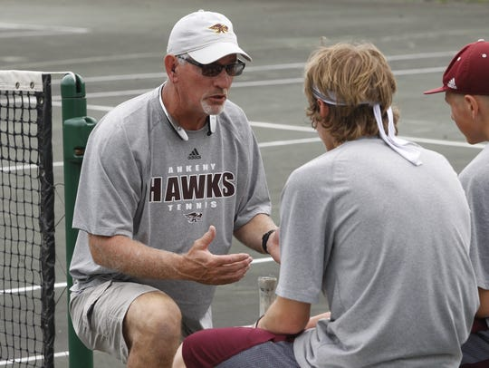 Ankeny coach Randy Daniels talks to his doubles team