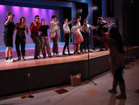 """Hairspray"" choreographer Harmony Malone rehearses ""(It's) Hairspray"" during an April 9 technical rehearsal at Ithaca High School."