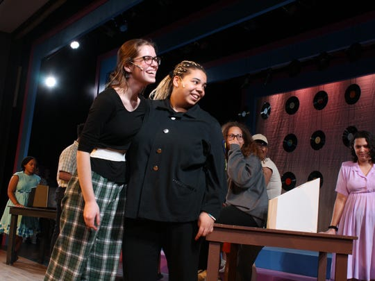 """Zoe Klausner and Maddi Carroll perform the roles of Penny Pingleton and Motormouth Maybelle during an April 9 technical rehearsal of """"Hairspray"""" at Ithaca High School."""