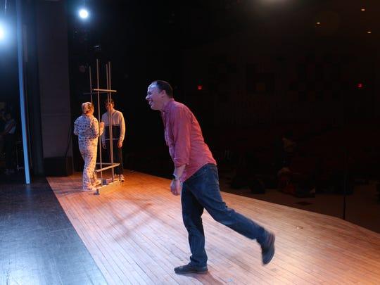 "Joey Steinhagen directs the cast of ""Hairspray"" at Ithaca High School."