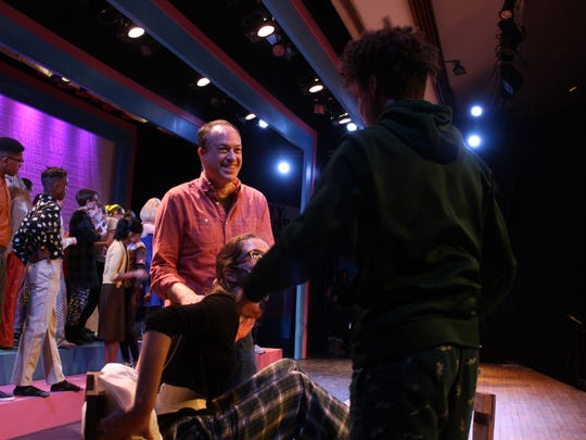 """Joey Steinhagen gives direction to members of the cast of """"Hairspray"""" during an April 9 technical rehearsal at Ithaca High School."""