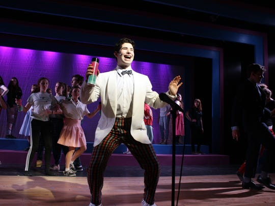 """Imri Leshed leads the cast of """"Hairspray"""" while rehearsing the musical number """"(It's) Hairspray"""" at Ithaca High School."""