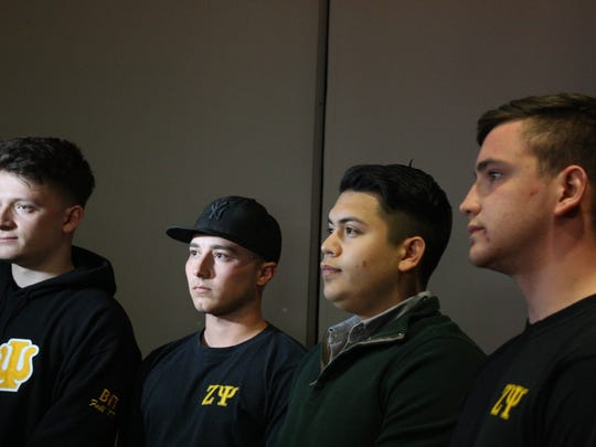 Zeta Psi Fraternity members, from left, Oliver Schoenfeld, Nicholas Poltorak, Daniel Greenberg and Daniel Grinberg organized a candlelight vigil Monday evening for their fraternity brother Joao Souza, who was fatally stabbed on April 15.