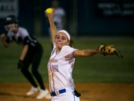 Barron Collier's Maddie Noble pitches the ball against