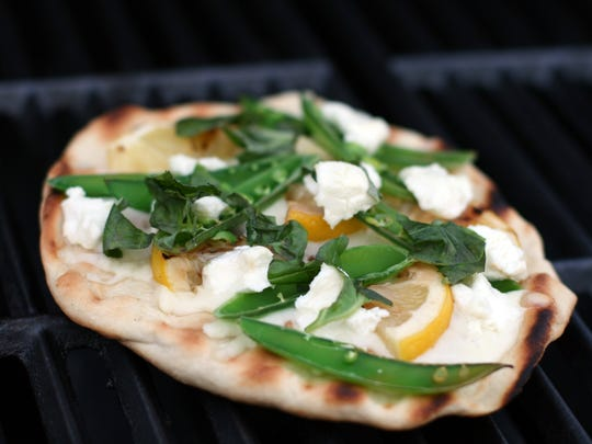 Snap Peas, Lemon and Goat Cheese Grilled Pizza is hot