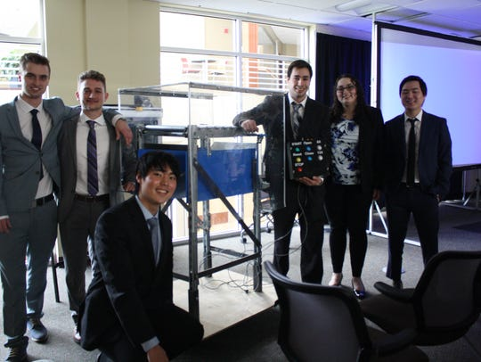 A team of Binghamton University senior biomedical engineering students and one junior computer engineering student won first prize at the CREATE Assistive Technology Competition for a product they created for AVRE that allows the company to hire legally blind employees.