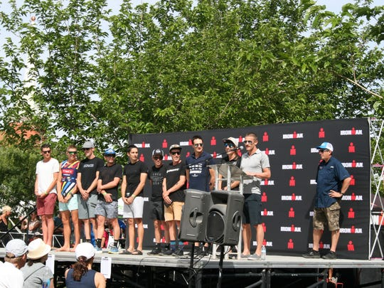 Winner Lionel Sanders (at podium) stands with the other top finishers of the 2018 St. George Ironman on May 5, 2018, at Town Square.
