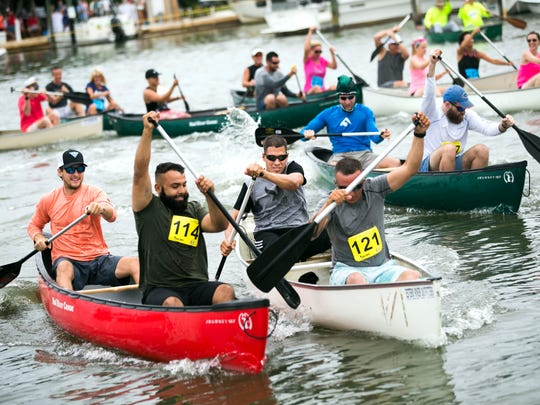 Paddlers battle to pull ahead from the starting line