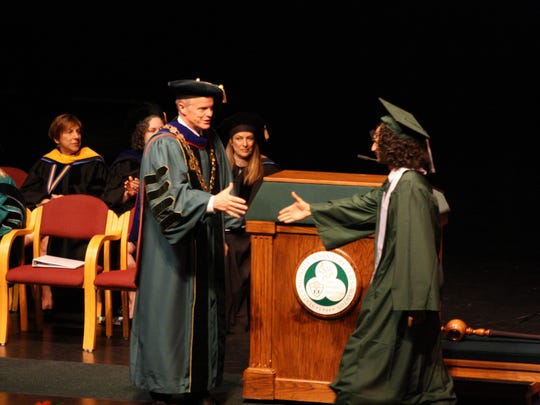 Binghamton University president Harvey Stenger congratulates
