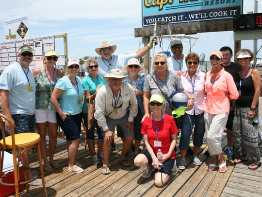 Part of the 2017 Blue Water Open Weigh-In Crew, from left, Dan Dickens, Mary Williamson, Angela Dickens, Bill Middleton, Marilyn Waldis, Pat Folkening, Ali Qizilbash, Karen McElveen, Kathy Falzone, Bladen Brisson, and Debbie Fitzpatrick.  Front and center are Michael Natale and Eva Chapman, co-chair and chair.