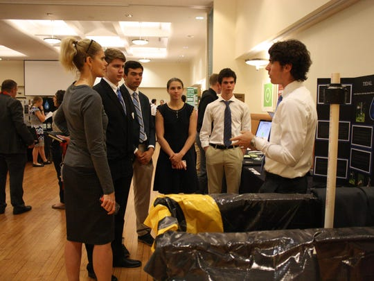 Students present their inventions during Thursday's Greater Binghamton Scholastic Challenge.