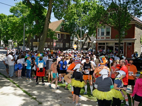 Beer stops are part of the course during the Riverwest Beer Run at Sunday's Locust Street Festival of Music & Art.